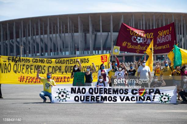 Protesters hold banners stating they don't want the Copa America, and want vaccineagainst coronavirus during a protest against the Copa America in...