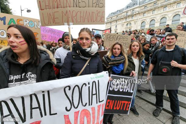 Protesters hold banners take part in a march in Paris in front of the Orsay Museum on November 20 2017 to protect the rights of social workers of the...
