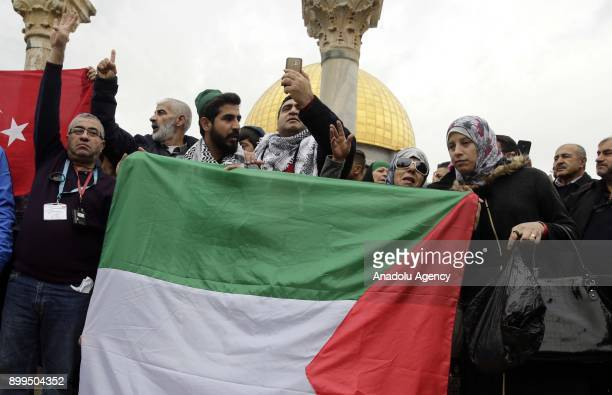 Protesters hold flags during a demonstration against US President Donald Trumps announcement to recognize Jerusalem as the capital of Israel and...