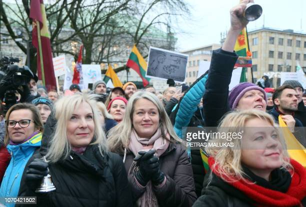 """Protesters hold flags during a peaceful protest titled """"Last call"""" held to show solidarity with more than a thousand teachers currently striking for..."""