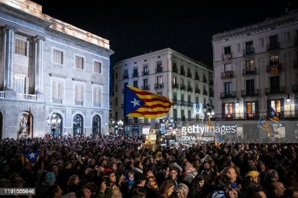 Protesters hold flags during the demonstration in Plaza de Sant Jaume. Hundreds of protesters for the independence of Catalonia have gathered in...