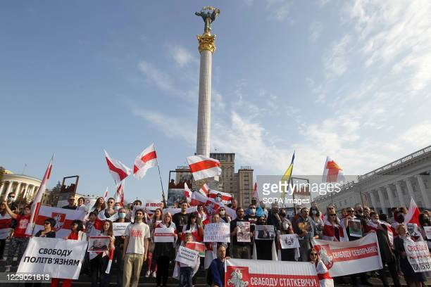 Protesters hold historical white-red-white flags of Belarus during the demonstration. Belarusian citizens who are living in Ukraine and Ukrainian...