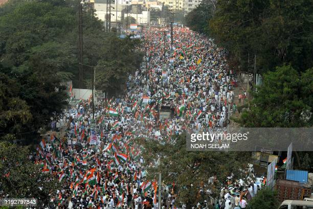Protesters hold national flags and shout slogans during a demonstration against India's new citizenship law in Hyderabad on January 10 2020
