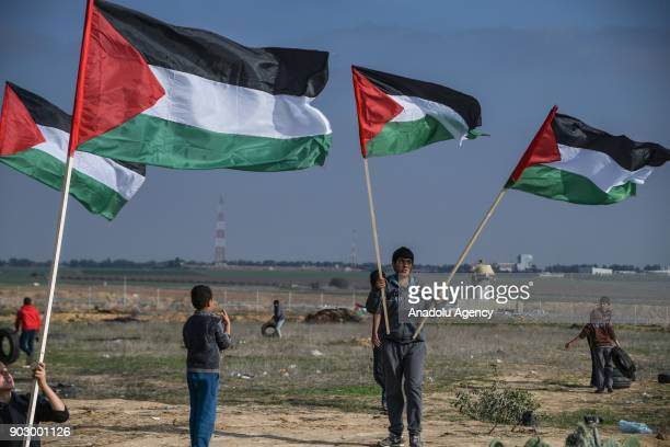 Protesters hold Palestinian flags during a protest against US President Donald Trumps announcement to recognize Jerusalem as the capital of Israel at...
