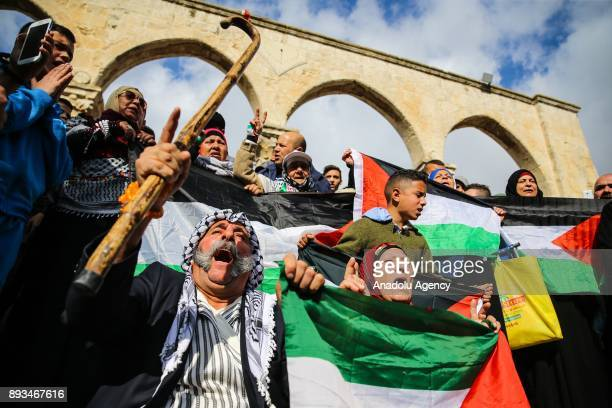 Protesters hold Palestinians flags during a demonstration against US President Donald Trumps announcement to recognize Jerusalem as the capital of...