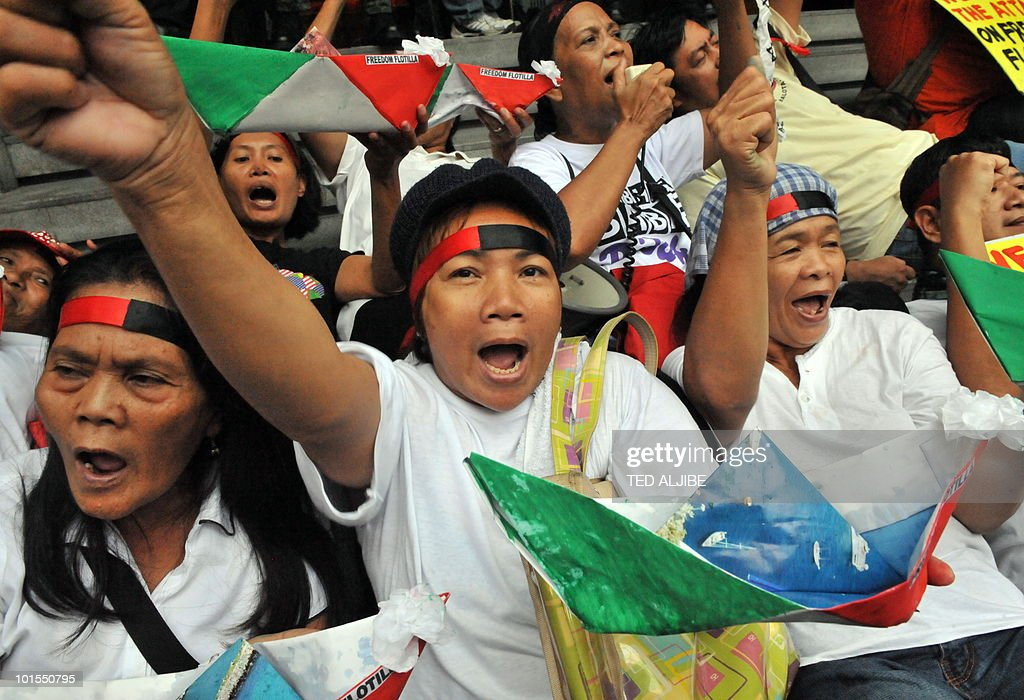 Protesters hold paper boats made in the colours of the Palestinain flag, symbolising the Gaza-bound aid flotilla seized by Israeli commandos in international waters on May 31, during a protest in front of the building housing the Israeli embassy in the financial district of Manila on June 2, 2010. Activists in the Philippines on June 2, strongly condemned what they called a brutal attack by Israel on a Gaza-bound aid flotilla that left nine people dead.
