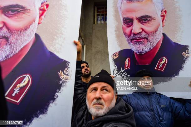 Protesters hold pictures of Iranian commander Qasem Soleimani during a demonstration outside the US consulate in Istanbul on January 5 two days after...