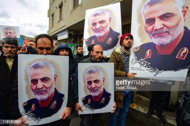 Protesters hold pictures of Iranian commander Qasem Soleimani, during a demonstration outside the US consulate in Istanbul, on January 5 two days...