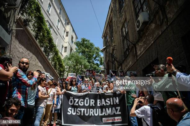 Protesters hold pictures of jailed RSF representative Erol Onderoglu journalist Ahmet Nesin and rights activist and academic Sebnem Korur Fincanci...