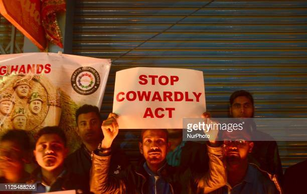 Protesters hold placard during a protest for the Paramilitary force of Central Reserve Police Force attack which killed more then 0 Indian CRPF in...