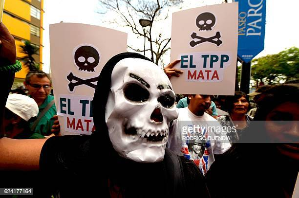 Protesters hold placards against the TransPacific Partnership during a rally on the sidelines of the AsiaPacific Economic Cooperation Summit in Lima...
