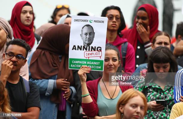 Protesters hold placards aloft as they march during the Stand Against Racism and Islamophobia Fraser Anning Resign rally on March 19 2019 in...