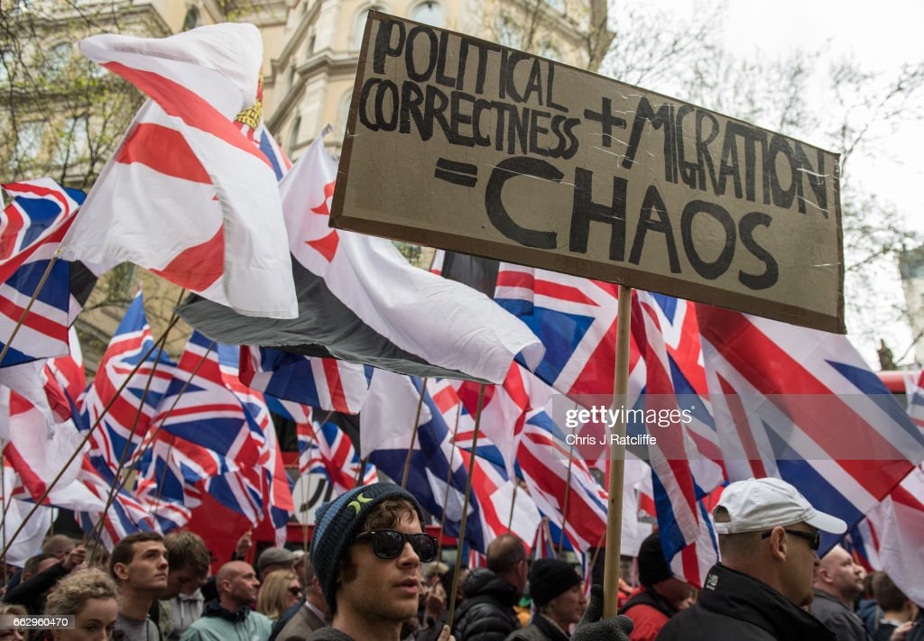 Protesters hold placards and British Union Jack flags during a protest titled 'London march against terrorism' in response to the March 22 Westminster terror attack on April 1, 2017 in London, England. The march has been organised by far-right groups English Defence League and Britain First, which also sees a counter-protest held by group 'Unite Against Fascism'. During the terror attack in Westminster, Khalid Masood killed 4 people as he drove a car into pedestrians over Westminster Bridge and stabbed PC Keith Palmer to death before being shot dead himself.
