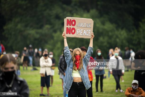 Protesters hold placards and chant during a demonstration against racism in Almere on June 14 2020 The antiracism demonstration was held to condemn...