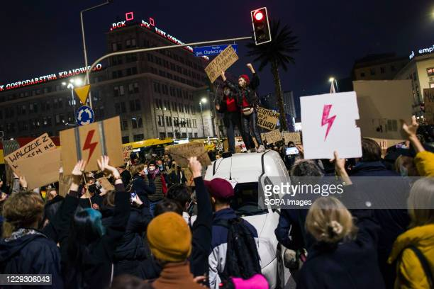 Protesters hold placards and chants anti government slogans during the protest. Thousands of people took to the streets of Poland for a fifth...