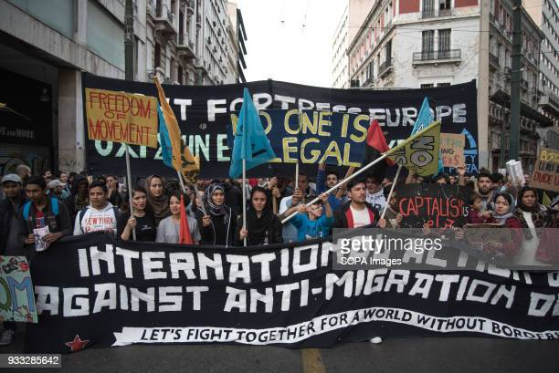 Protesters hold placards and flags and shout slogans against racism Mass participation in the antifascist demonstration in Athens Antiracist and...