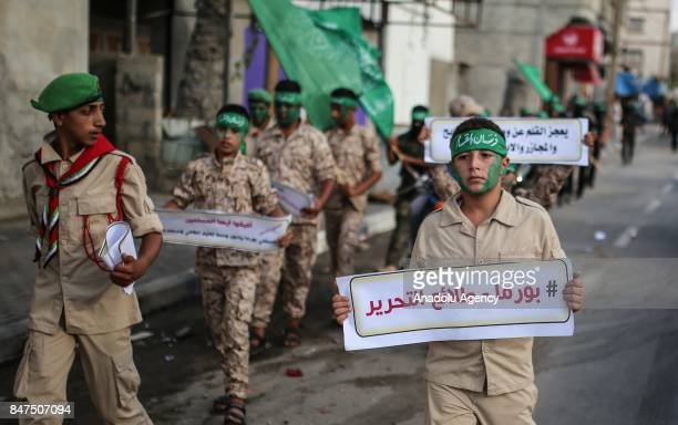 Protesters hold placards and Hamas' flags during a protest against Myanmar's oppressions towards Rohingya Muslims on September 15 Gaza City Gaza