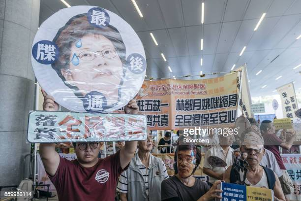 Protesters hold placards and shout slogans ahead of Hong Kong's Chief Executive Carrie Lam's policy address outside of the Legislative Council in...