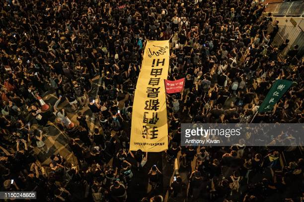 Protesters hold placards and shout slogans as they march during a protest against the nowsuspended China Extradition Law on June 16 2019 in Hong Kong...