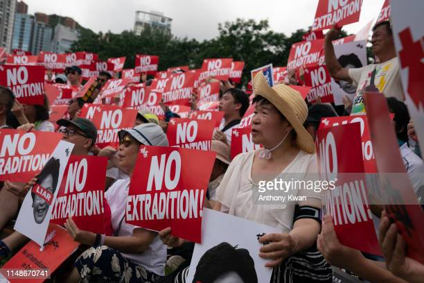 Protesters hold placards and shout slogans during a rally against the extradition law proposal on June 9 2019 in Hong Kong China Hundreds of...