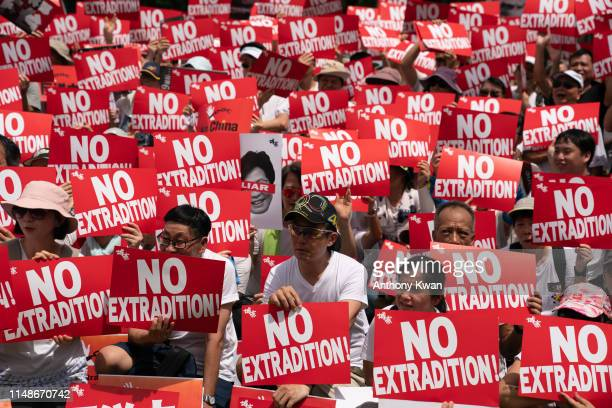 Protesters hold placards and shout slogans during a rally against the extradition law proposal on June 9, 2019 in Hong Kong China. Hundreds of...