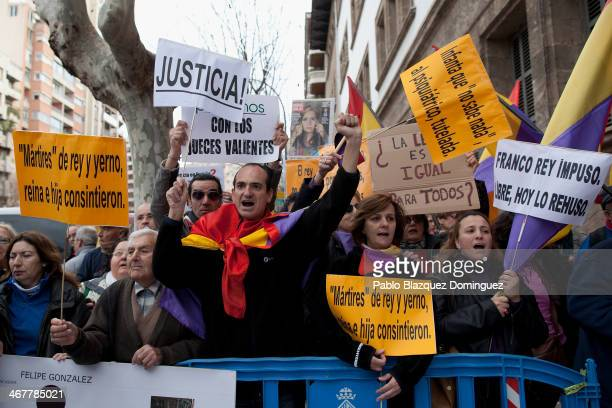 Protesters hold placards and shout slogans outside the Palma de Mallorca Couthouse where Princess Cristina of Spain is giving evidence during the...