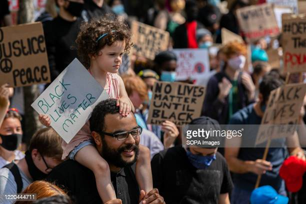 Protesters hold placards as they march during a demonstration. Thousands of demonstrators gather in Millennium square as part of the Black Lives...