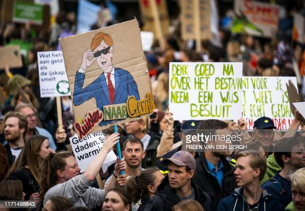 Protesters hold placards as they participate in the Global Climate Strike organised by the Fridays For Future at the end of the global climate change...