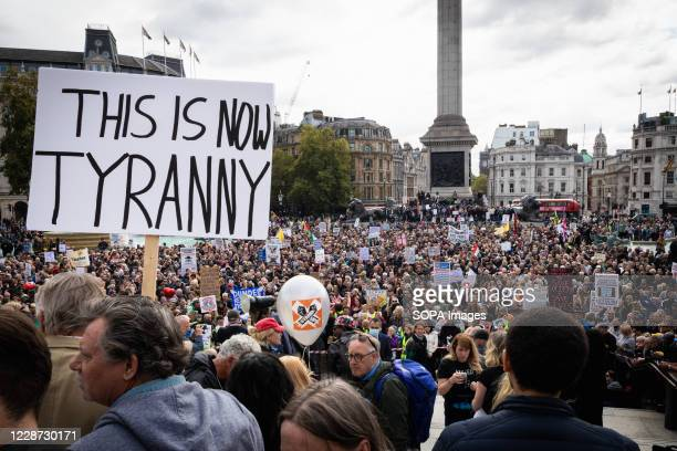 Protesters hold placards at Trafalgar Square during a rally against the Coronavirus Act 2020 Unite for Freedom protesters gathered at Trafalgar...