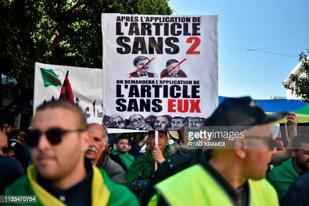 Protesters hold placards during a demonstration against ailing President Abdelaziz Bouteflika in the capital Algiers on March 29 2019 Opposition to...