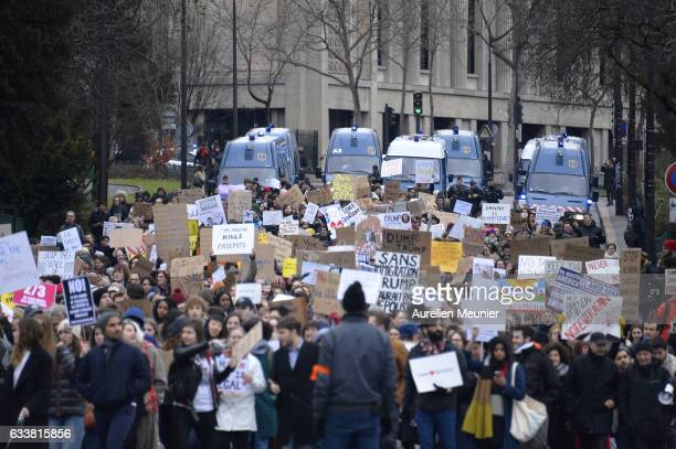 Protesters hold placards during a demonstration against Donald Trump on February 4 2017 in Paris France After US President Trump signed an executive...