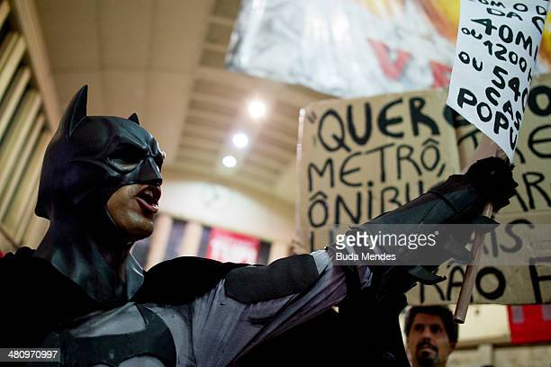 Protesters hold placards during a demonstration against the 2014 FIFA World Cup Brazil at Central do Brasil train station on March 27 2014 in Rio de...