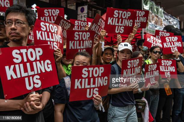 Protesters hold placards during a demonstration against the nowsuspended extradition bill on June 16 2019 in Hong Kong Large numbers of protesters...