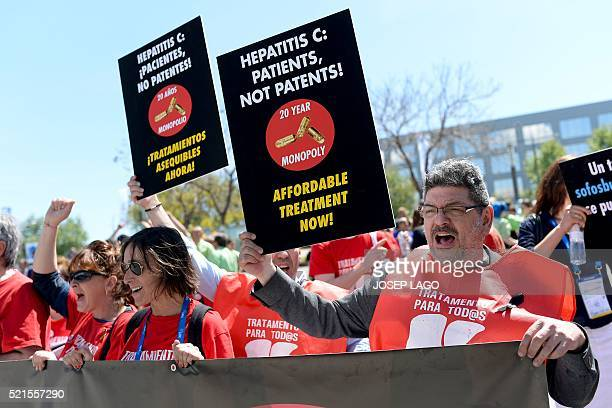 Protesters hold placards during a demonstration called by several organizations and people affected by th hepatitis C virus demanding the need to...