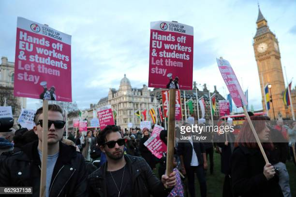 Protesters hold placards during a demonstration in Parliament Square on March 13 2017 in London England Labour Party Shadow Chancellor of the...