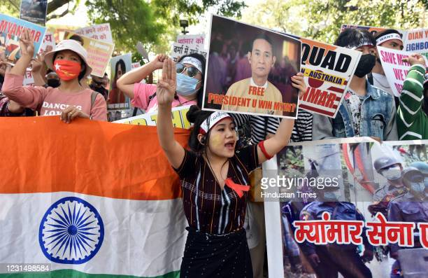 Protesters hold placards during a demonstration to protest against the military coup in Myanmar, at Jantar Mantar Road on March 3, 2021 in New Delhi,...