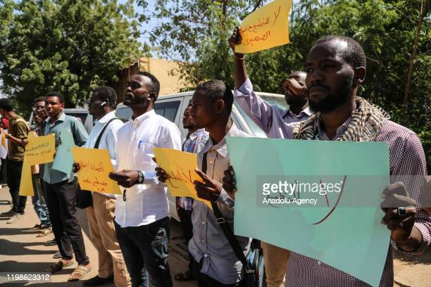 Protesters hold placards during a protest against meeting of Sudan's Sovereign Council Head AbdelFattah alBurhan and Prime Minister of Israel...