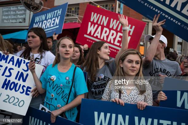 Protesters hold placards during the democratic debate in support of Elizabeth Warren in Westerville