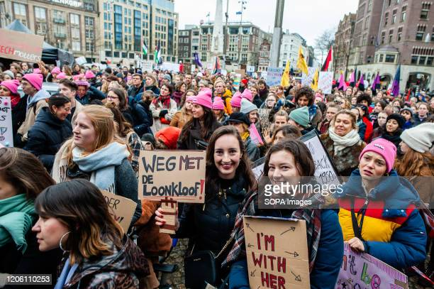 Protesters hold placards during the demonstration. During the International Women's day, thousands of women gathered at the Dam Square in the center...