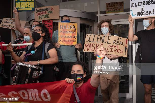 Protesters hold placards during the demonstration. In Dublin, Ireland, another day of protests against the Brazilian President Jair Bolsonaro took...