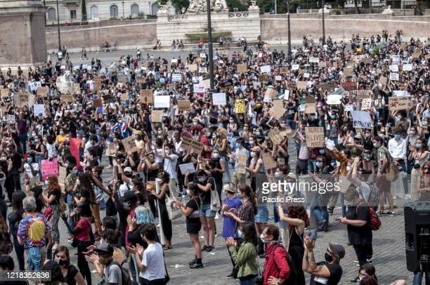Protesters hold placards for justice Thousands of people demonstrated in Rome in Piazza del Popolo to say no to all forms of racism and to remember...