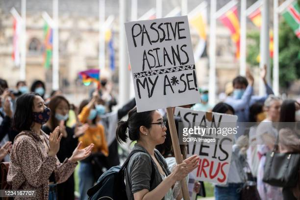 Protesters hold placards outside Parliament Square during the Stop Asian Hate rally in London. Demonstrators held a protest against the increasing...