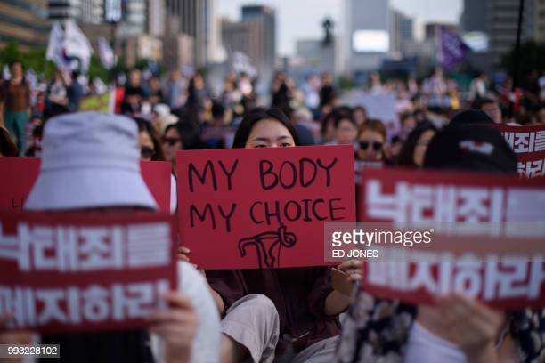 TOPSHOT Protesters hold placards reading 'Abolish punishment for abortion' as they protest South Korean abortion laws in Gwanghwamun plaza in Seoul...