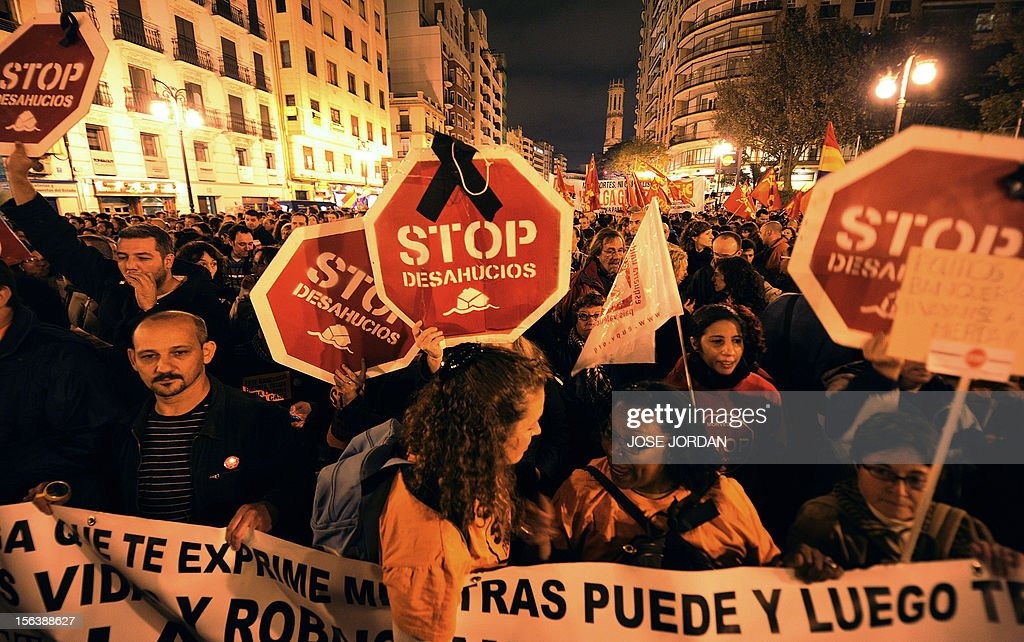 Protesters hold placards reading 'Stop evictions' as they attend a demonstration during a general strike on November 14, 2012 in Valencia. The second general strike this year hit Spain with protesters marching in several cities against sweeping austerity measures and high unemployment, scenes echoed elsewhere in Europe. Spain, the eurozone's fourth-biggest economy, is suffering 25 percent unemployment, with the rate even higher amongst young people.