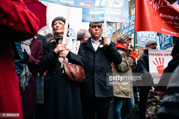 Protesters hold placards Thousands of demonstrators amassed in London on Saturday to garner support for higher NHS funding as the worst winter on...
