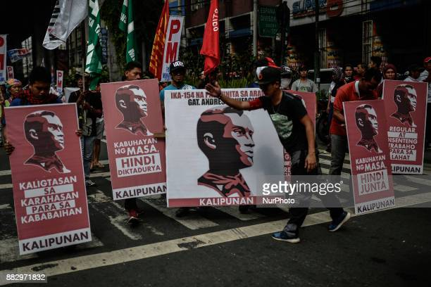 Protesters hold placards with portraits of Filipino revolutionary leader Andres Bonifacio during a demonstration against President Rodrigo Duterte in...