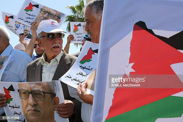 Protesters hold portraits of prominent Jordanian writer Nahed Hattar who was shot dead the previous day outside an Amman court during a demonstration...