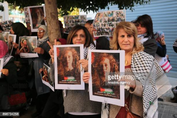 Protesters hold posters during a protest held to show their support for 16yearold Palestinian Ahed alTamimi who was taken into custody by Israeli...