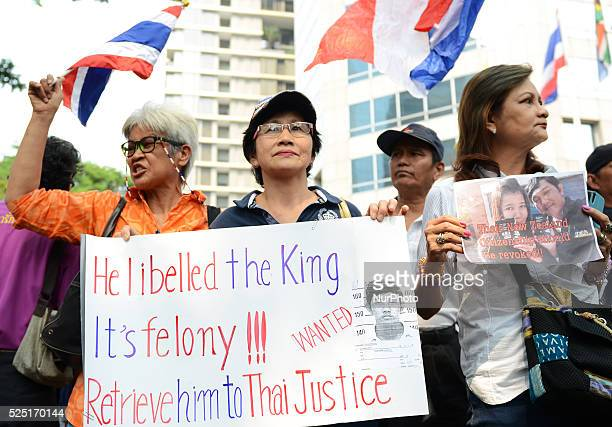 Protesters hold sign during protests again New Zealand about Eakapop Luara at New Zealand Embassy in Bangkok Thailand on January 23 2015 Eakapop also...