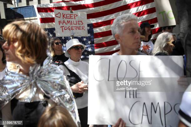 Protesters hold signs during a demonstration against migrant detention facilities on July 2 2019 in San Francisco California Hundreds of protesters...